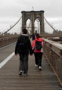 Anne and Kerri crossing the Brooklyn bridge.