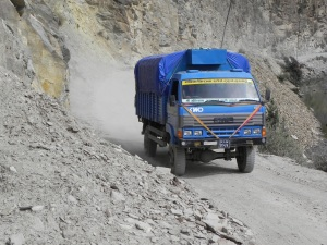 This is what I mean about the trafic kicking up dust! As you can see these trucks are quite small and have good road clearance!