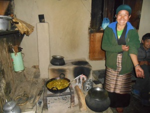 Lhamu in her kitchen. Yes that is the stove. The only cooking implement and source of heat for the home.
