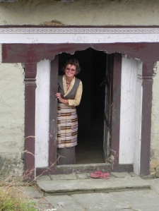 Me at the door of Tendi and Lhamu's home. This gives you an idea of the low doorways. I'm tall around here, a novel change.