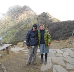 Tendi and I at High Camp at 6:30 on a very chilly morning, just before we headed up to a higher view point which you can see behind us.