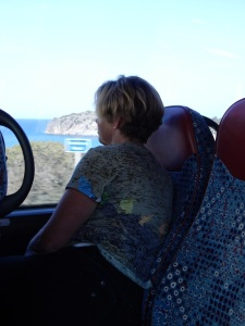 Kathy in her comfortable bus seat enjoying the view.