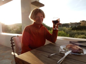 Our current abode at Red Tractor Farm is an outstanding studio. Here's Kathy enjoying a glass of wine on our front balcony. We also have a private little courtyard garden!