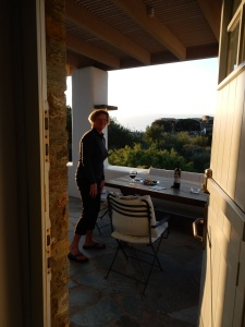 Kathy, our balcony, sunset of our final day.